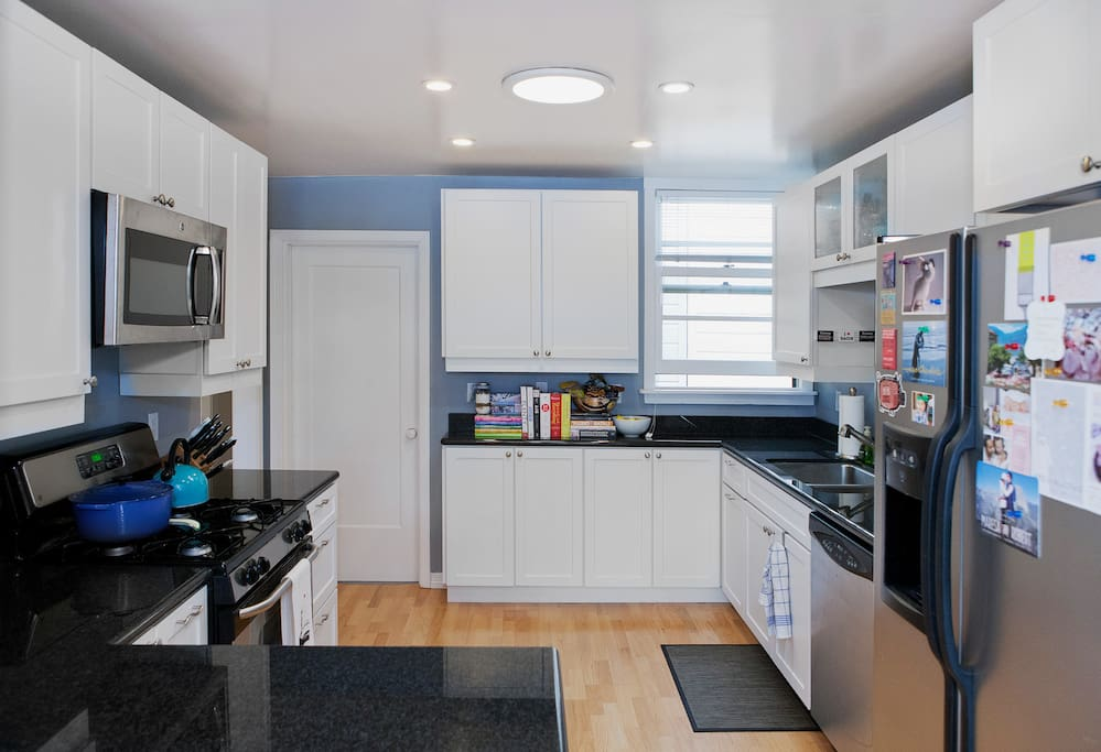 Large, open kitchen. Gas stove, oven, dishwasher, microwave etc.