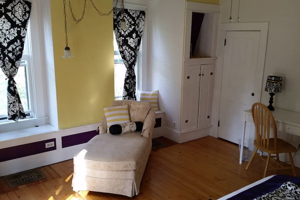 Large Sunny Room with a desk and lots of built in storage and a walk in closet