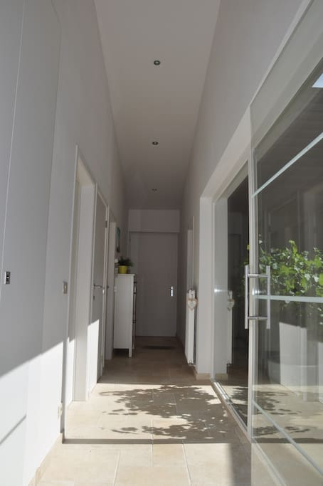 The corridor, with your private bedroom, toilet and bathroom.