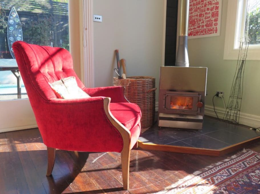 This is why I love winter. A wood burner and my red velvet chair.  Delicious.