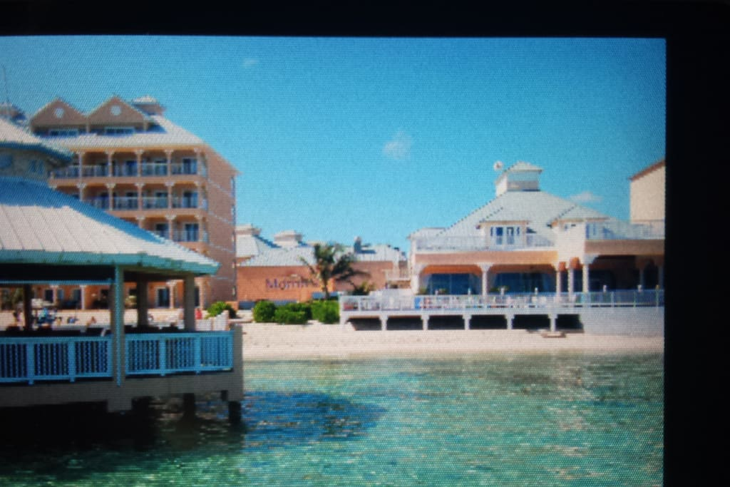 Apartment Building on the left.  View from the Pier and Mimi's Bar.
