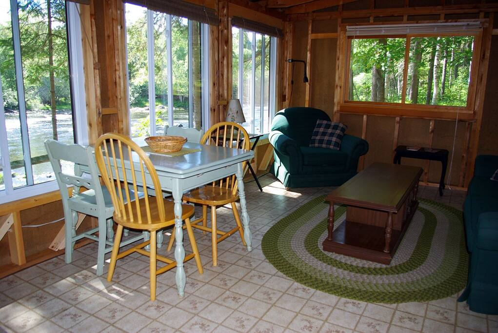 Dining and living area overlooking the Upper Conroy Rapids on the York River