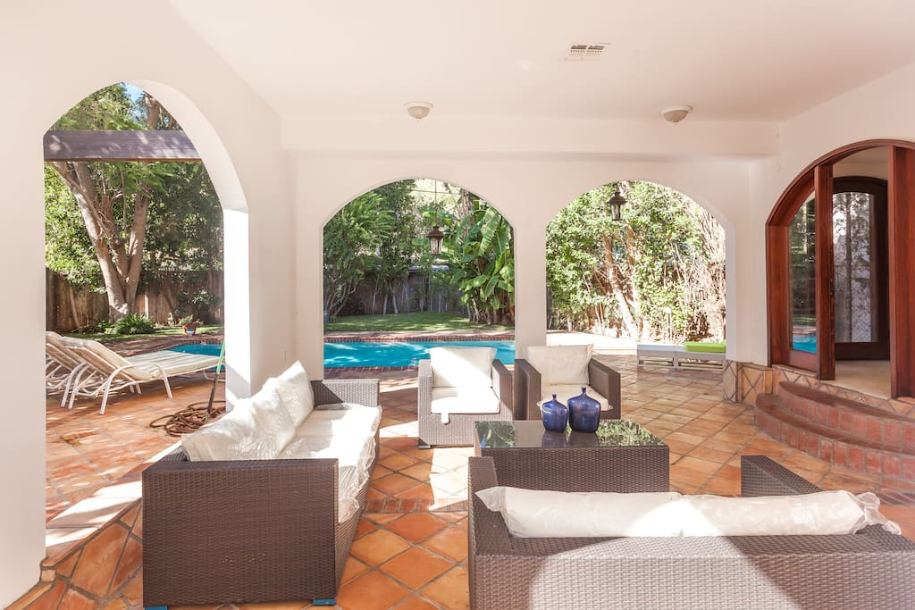 Outdoor living area that is open to the pool area.