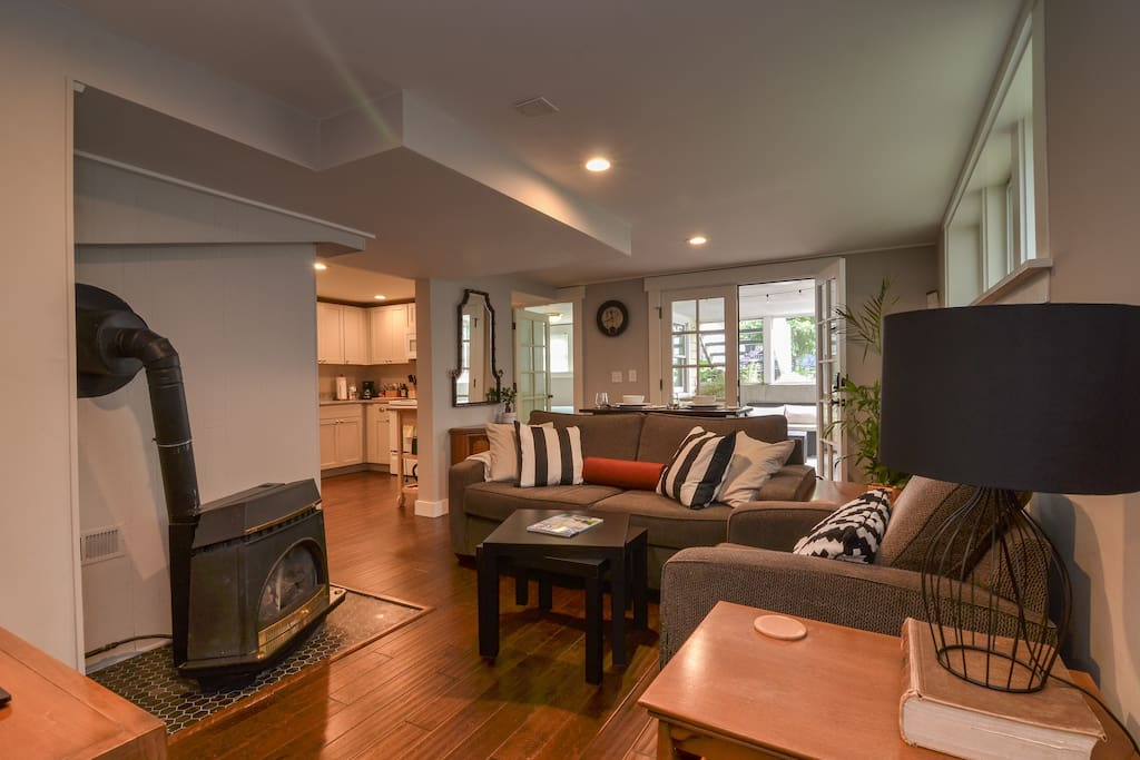 The living area has comfortable seating to relax, watch TV, and eat dinner.