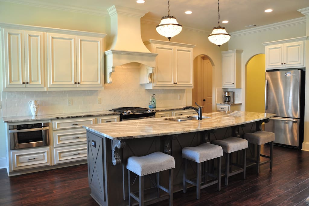 Kitchen with exotic granite, stainless steel appliances and large island