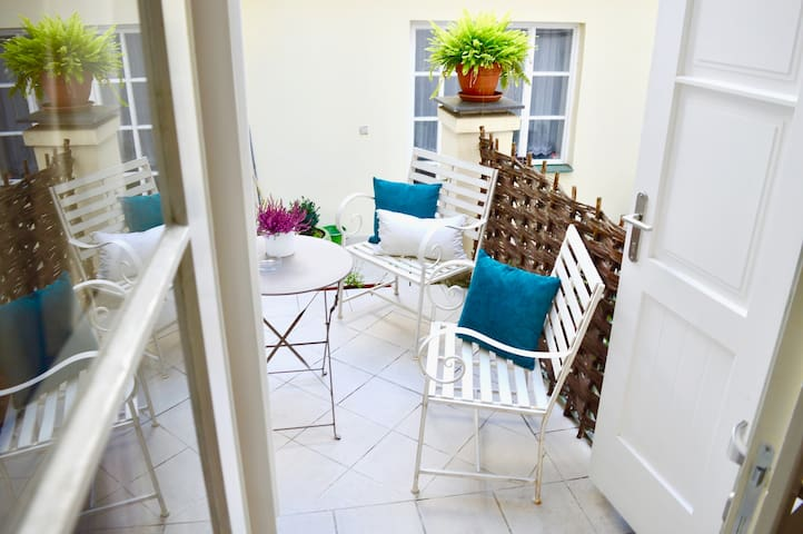 Step out from the quiet main bedroom on to this spacious patio ideal for al fresco dining a enjoying a glass of wine or breakfast.