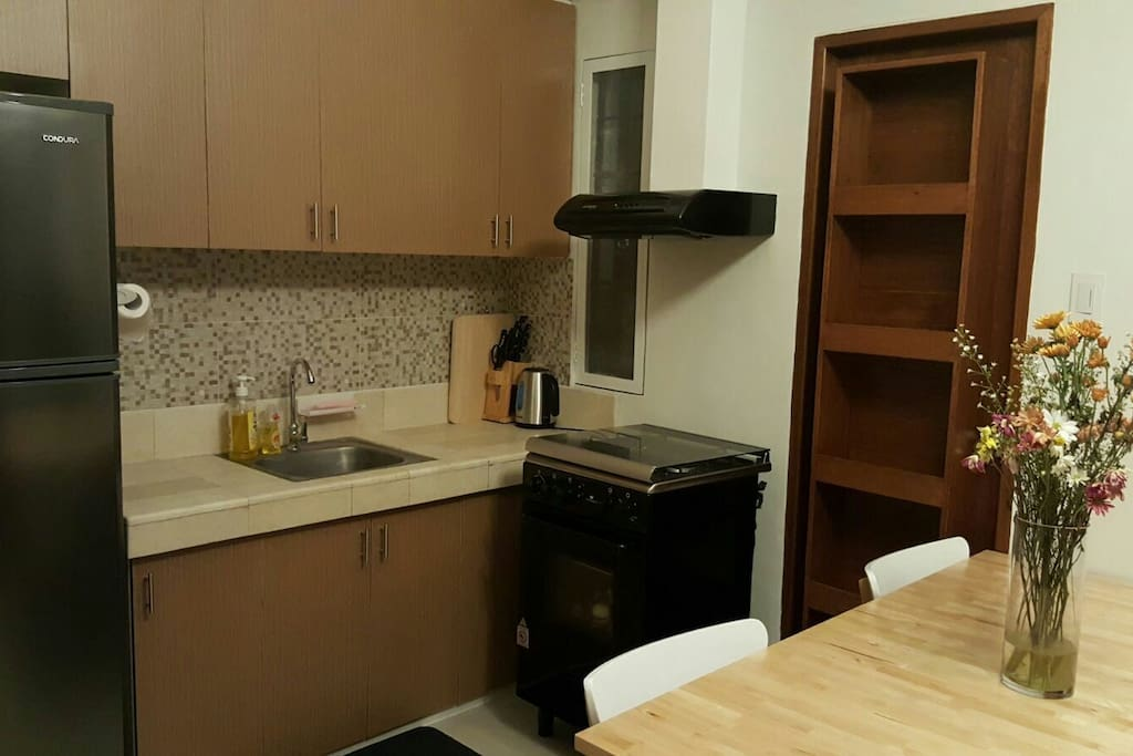 11cubic Fridge, gas range with oven, rice cooker and basic kitchen and dinning wares.