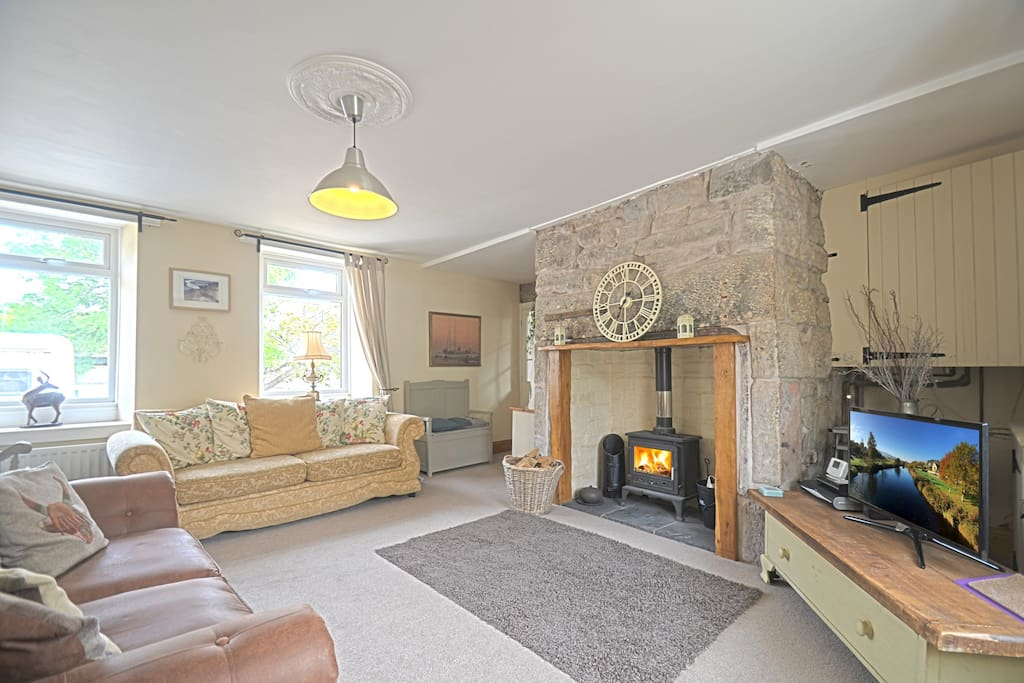 The cosy Living Room with sky TV and log burning stove.