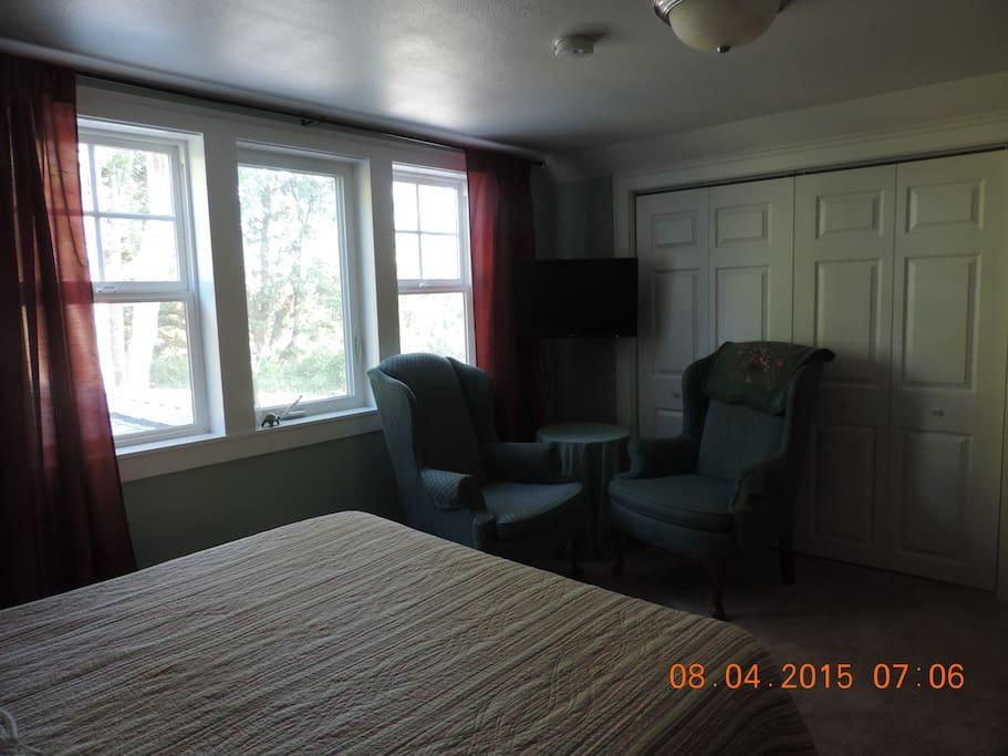TV, seating, closet