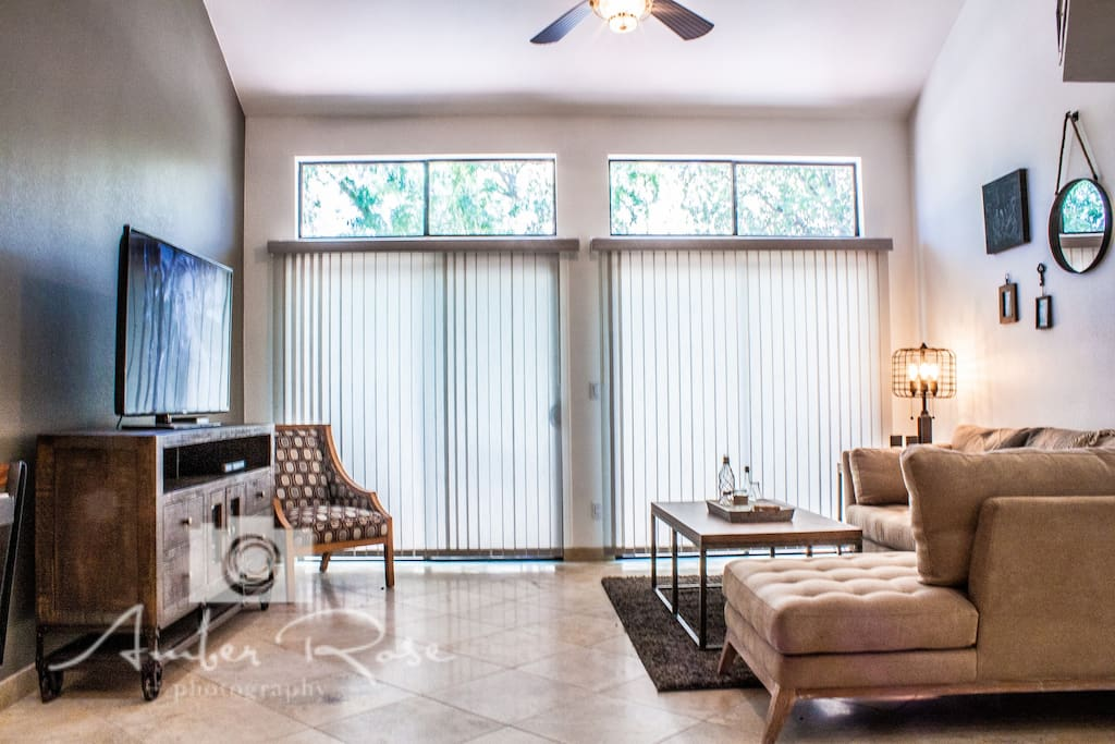 Living room with vaulted ceilings.