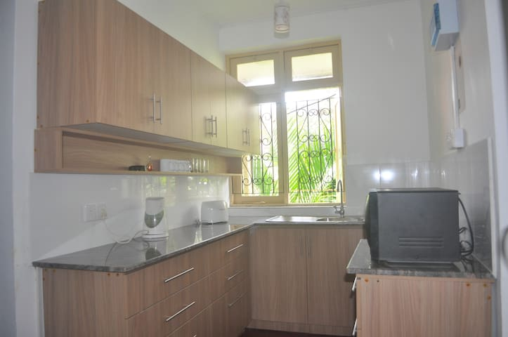 Brand new kitchen with electric kettle, toaster and cutlery, crockery and all cooking essentials.