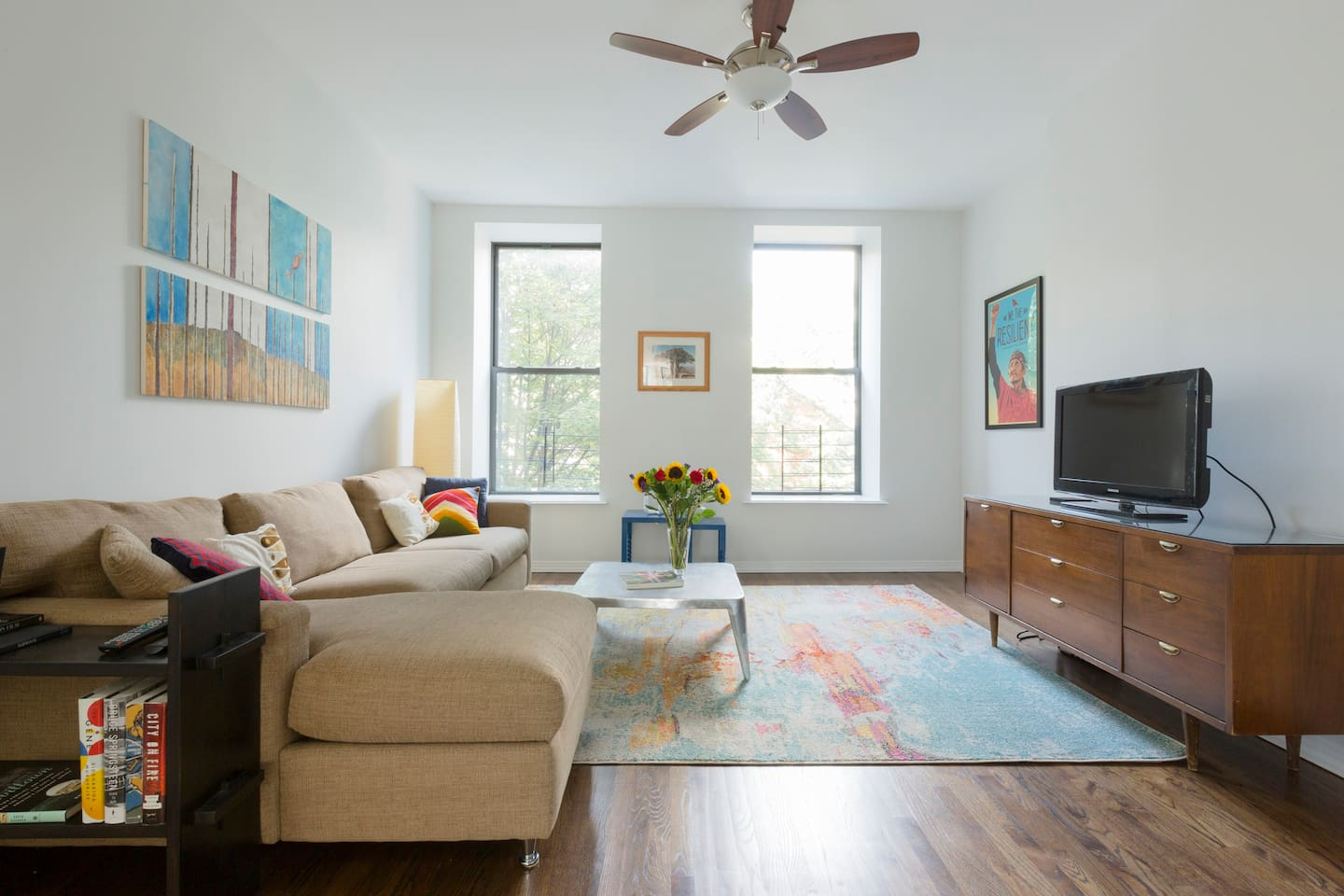Apartment is the top two floors of a Harlem brownstone built c 1908 and renovated in 2007. The first level is a public space with dining, kitchen and living rooms.