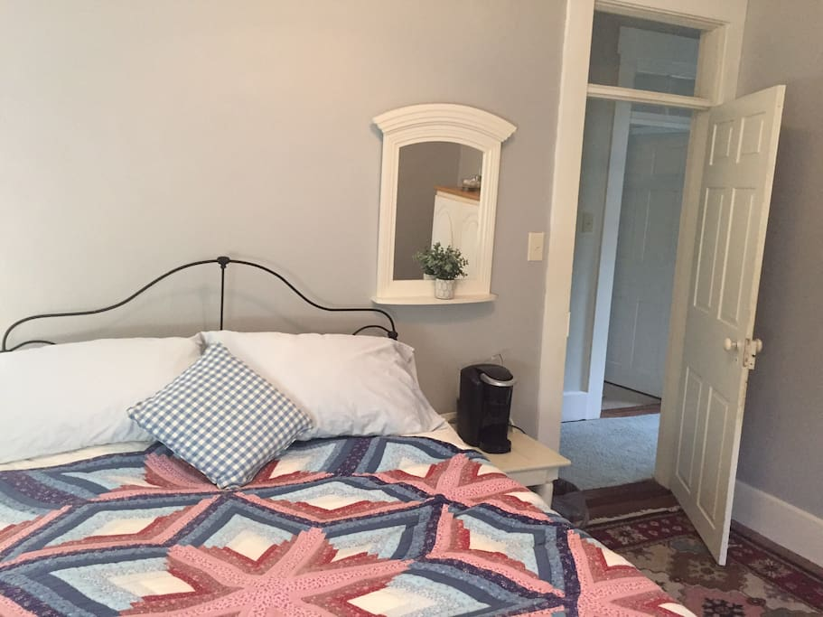 This bedroom has a Kureg coffee maker with assorted coffee and creamers available.