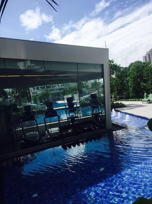 Glass gym room and swimming pool