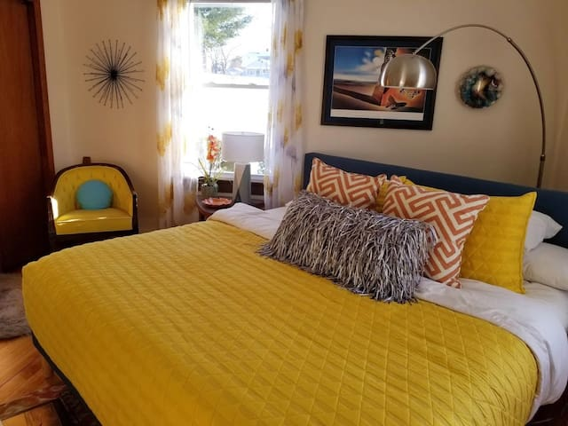 The yellow bedroom is a happy, sunny place! (Our parents' old room...holds happy memories, too.)