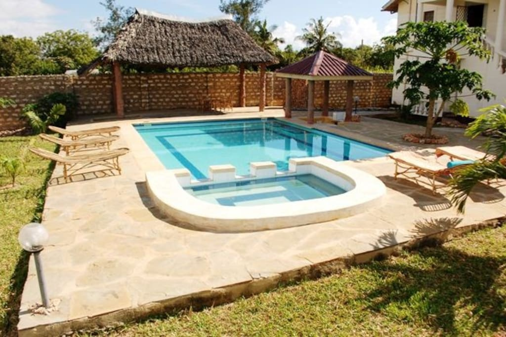 Swimming pool with a sunken bar