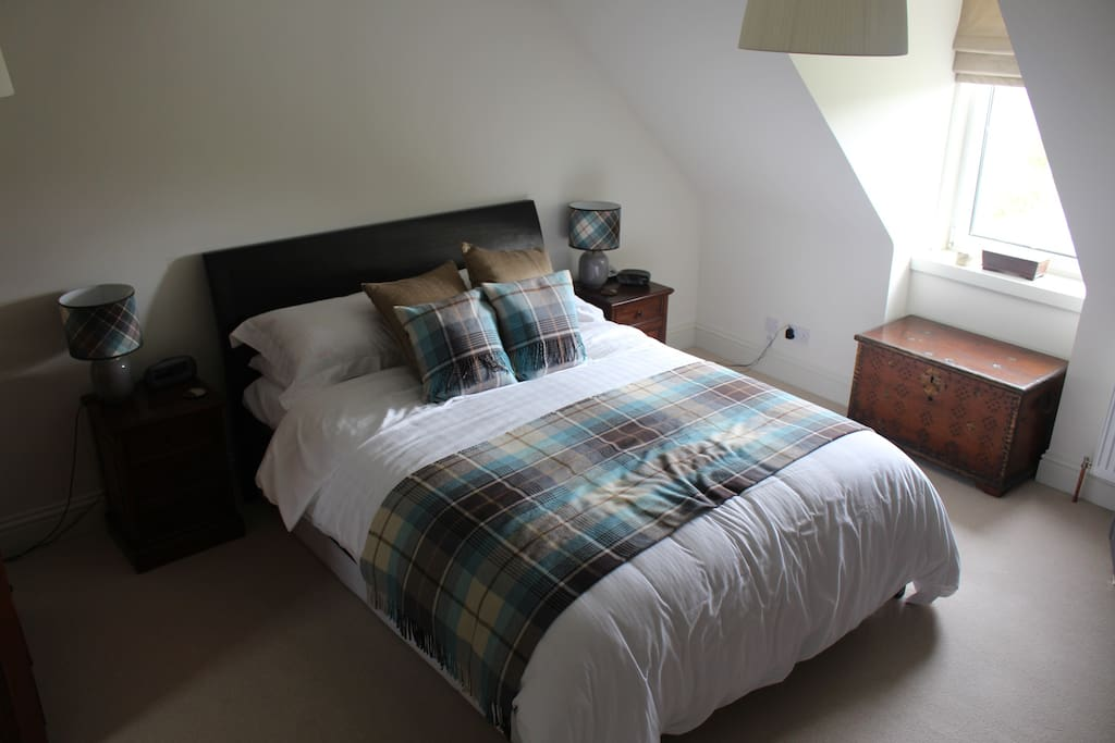Master Bedroom with king size bed and 2 large chest of drawers