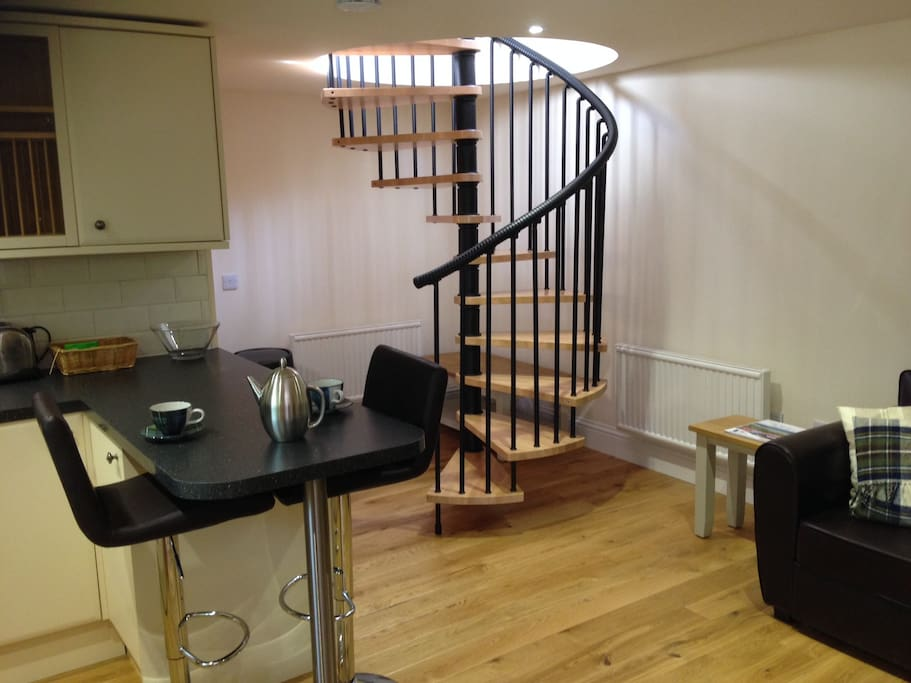 As you walk in you have the kitchen, lounge and spiral staircase ahead of you.