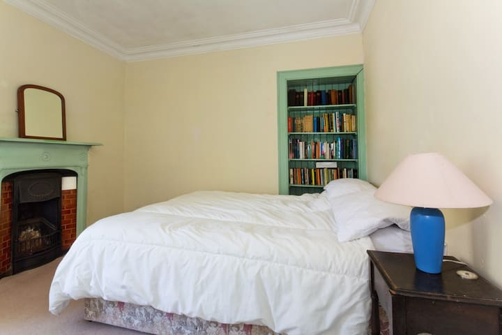 The downstairs double bedroom. The window beyond the left of the image looks across the garden and Glenelg Bay to Skye.