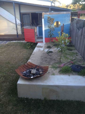 Fire pit (wood provided) and cubby house.