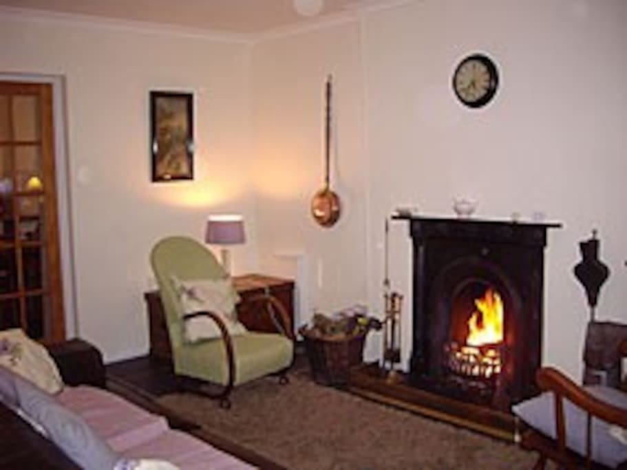 The cosy living room with open fire