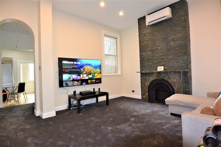 """Massive 75"""" Inch Sony 4K TV with Bose Surround Sound System."""