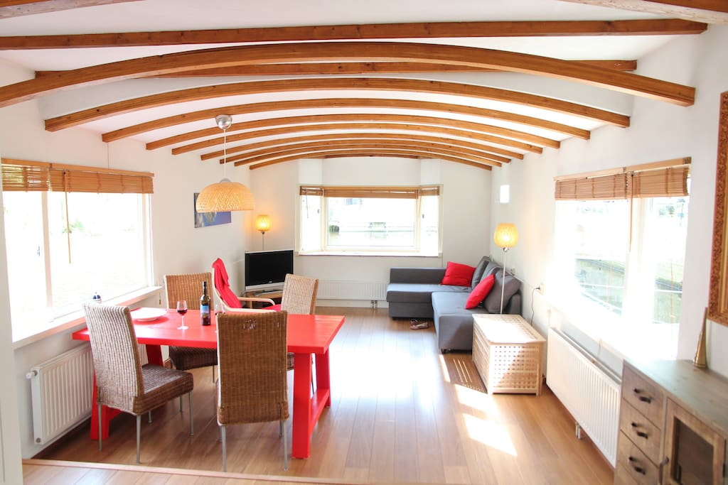 The bright and spacious living room has views on three sides over the water!