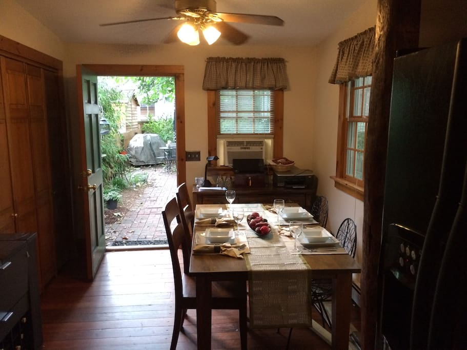 Original hardwood floors! Dining area leading to the back patio and eating/grilling area.