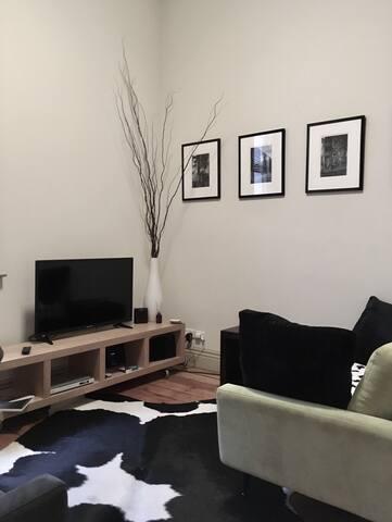Lounge Area, large TV, DVD, Music.