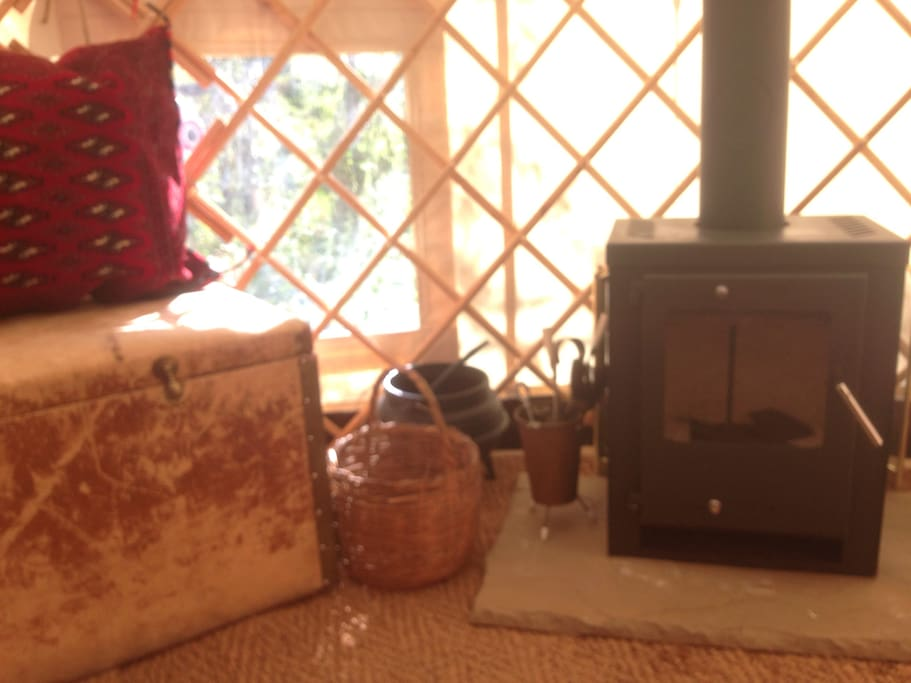 Large nodern wood burner keeps the yurt nice and cozy