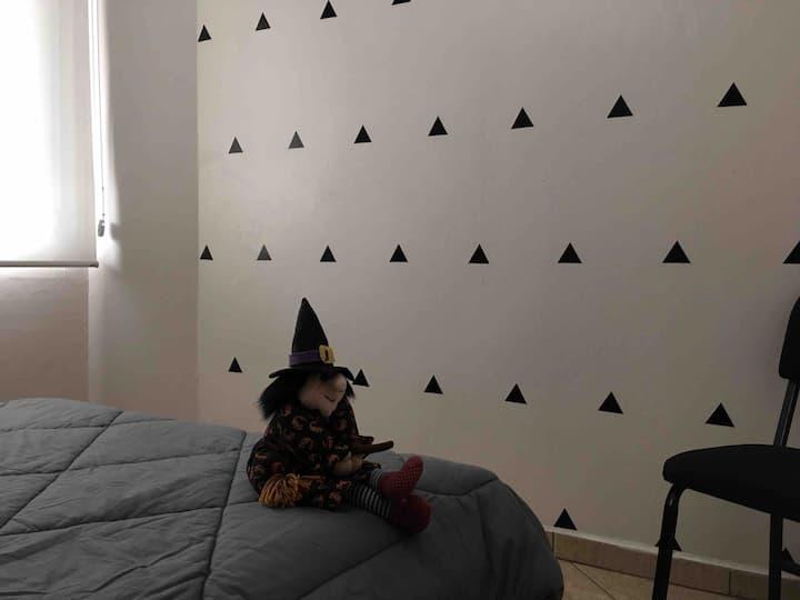 Quarto em apartamento no centro de Casca RS