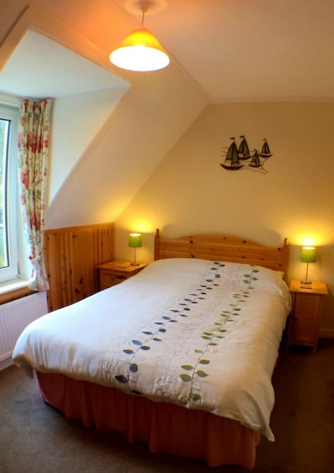 Double en-suite room with garden view.