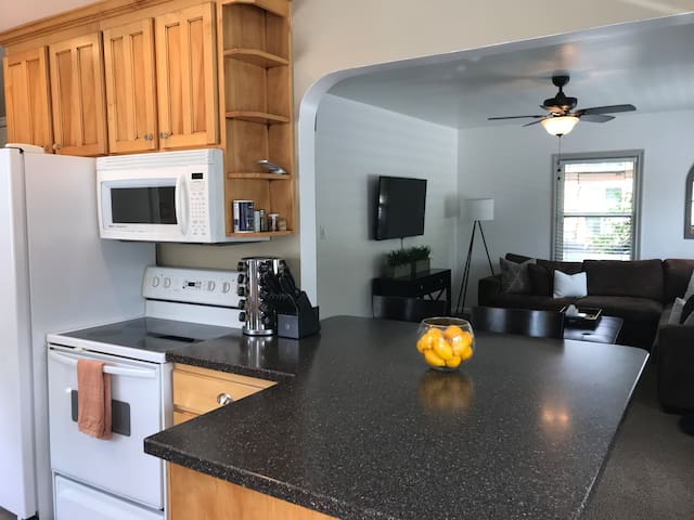 You can cook while watching some tv or talking to friends and family hanging in the beautiful living room.