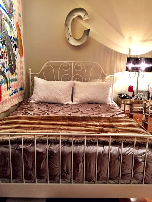 Queen size bed with brand new top of the line mattress.