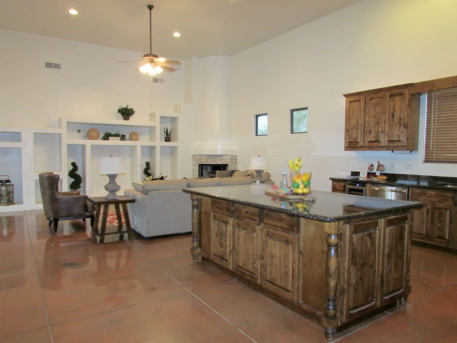Large kitchen w/ large island and living room in background