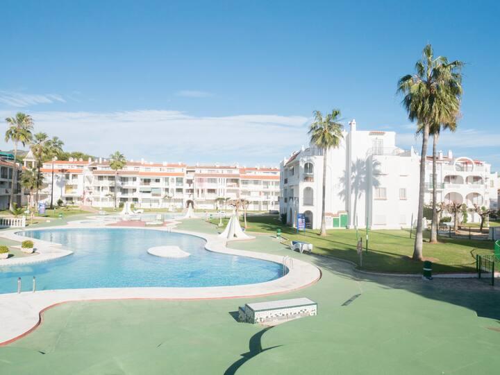 Playa Romana Village 1 dormitorio vista jardín