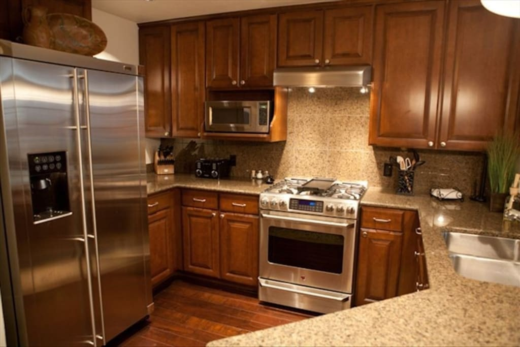 Granite counter tops and stainless-steel appliances.