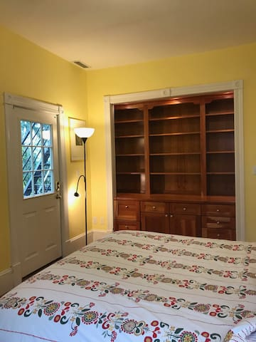 Your room with queen size bed, fold out single bed chair, desk, beautiful built in shelves and optional  fire escape entrance