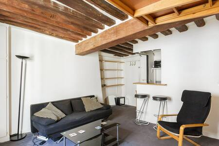 """This nice studio is perfectly located in the heart of the Marais the beating heart of """"Le Paris Branché"""" one studio with a 2 person Bed 180 on Mezzanine and a sofa bed, bathroom with shower, equipped kitchen corner"""