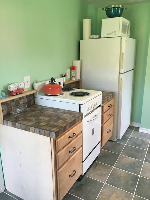 New retro kitchen! Complete with dishes and pans, stove, fridge, and microwave.
