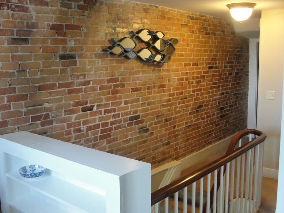 The beautiful original brick wall that's over 150 years old!