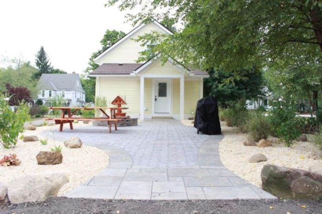 Private patio entrance with propane grill, natural gas fire place, seating for 10 at the table for an outdoor meal & even a wishing well to toss your dreams into!