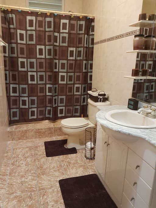 Spacious private bathroom with lock on door.