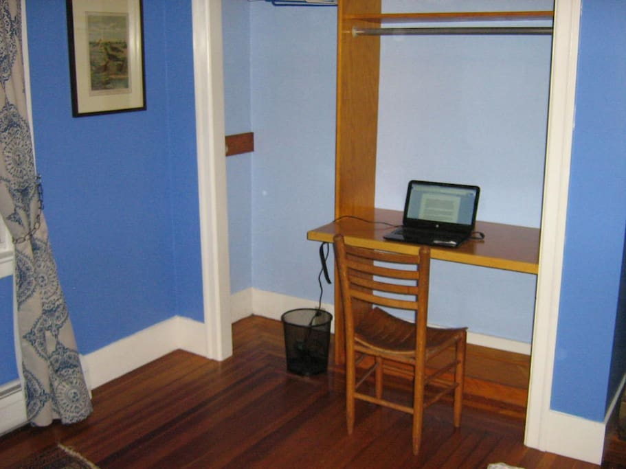 Desk space with grounded outlet and wifi.