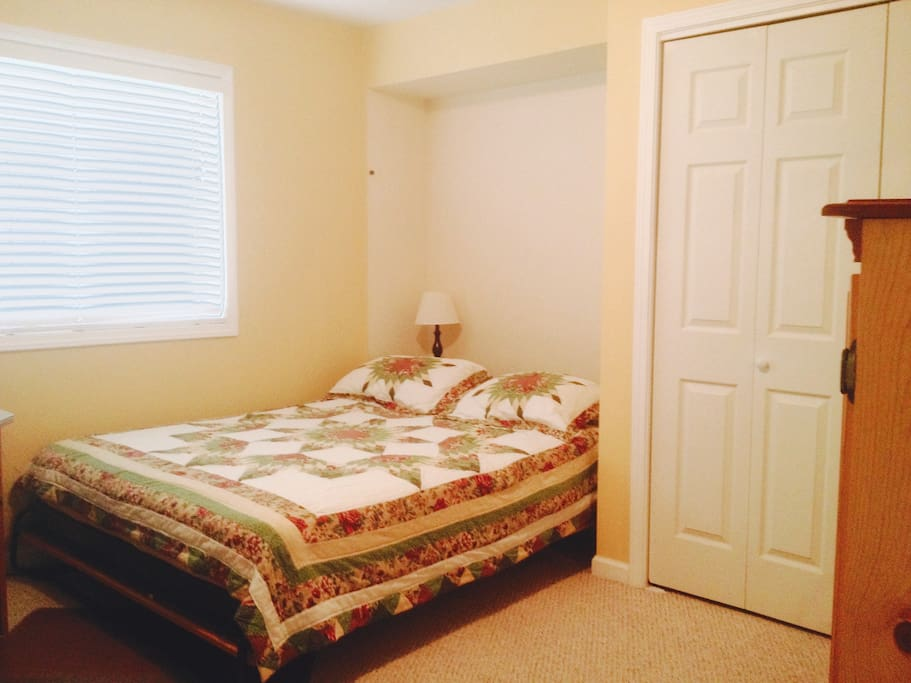 Our queen sized murphy bed folds in the wall for extra room