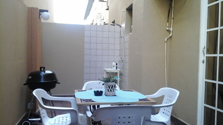 Private tiled patio with a shower, 3 clothing strings, & bbq