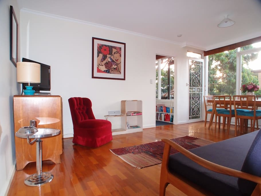 Living room full of natural light. Includes tv, dvd player, bluetooth speaker for music and lots of Melbourne travel information.