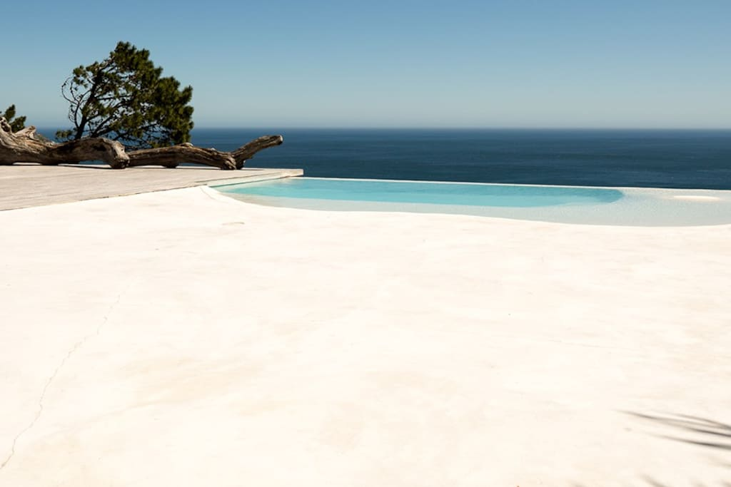View of ocean and beach from the large second deck with infinity pool