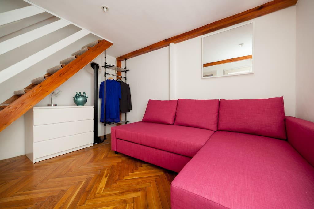 Room with openable double sofa-bed
