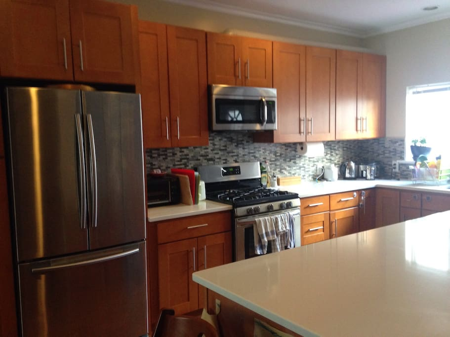 Large kitchen with tons of counter space, dishwasher and new appliances.